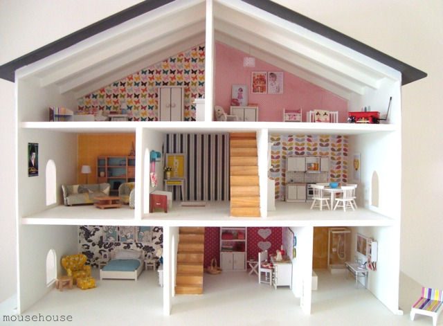 I love how she made miniature versions of the art from her real house for  this mini version. I am so regretting giving away B's dollhouse when we  moved!