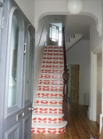 Orla Kiely wallpaper stairs, Happily Nested